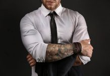 guy in dress shirt with tattoos on arms