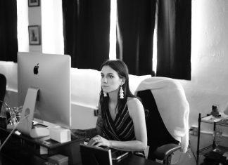 michaela sitting at desk
